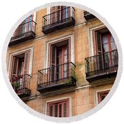 Round Beach Towel featuring the photograph Tiny Iron Balconies by T Brian Jones