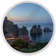Round Beach Towel featuring the photograph Tonnara And Faraglioni Rocks In Scopello At Dusk by IPics Photography
