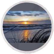 Round Beach Towel featuring the photograph Touching The Sunset by Kicking Bear Productions
