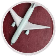 Round Beach Towel featuring the photograph Toy Airplane Over Red Book Cover by Edward Fielding