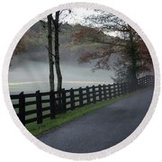 Tree Lined Road In The Fog Round Beach Towel