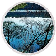 Tree Overhang Reflected In The Water Round Beach Towel by Joy Nichols