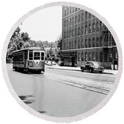 Round Beach Towel featuring the photograph Trolley With Packard Building  by Cole Thompson