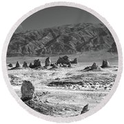 Trona Pinnacles With The Moon Round Beach Towel by Marius Sipa