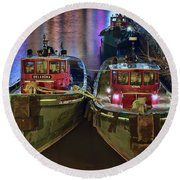 Round Beach Towel featuring the photograph Tug Boats At Night by Frozen in Time Fine Art Photography