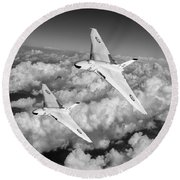 Round Beach Towel featuring the photograph Two Avro Vulcan B1 Nuclear Bombers Bw Version by Gary Eason