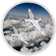 Round Beach Towel featuring the photograph Two Avro Vulcan B1 Nuclear Bombers by Gary Eason