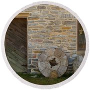Two Mill Stones Against Building Round Beach Towel