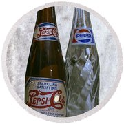 Two Pepsi Bottles On A Table Round Beach Towel