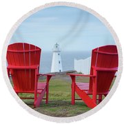 Two Red Adirondack Chairs Looking Out To A Lighthouse Round Beach Towel