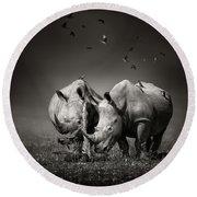 Two Rhinoceros With Birds In Bw Round Beach Towel