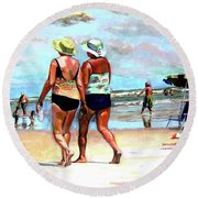 Two Women Walking On The Beach Round Beach Towel
