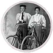 Two Young Ladies With Their Bicycles Circa 1895 Round Beach Towel