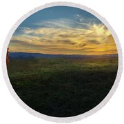 Under A Bright Evening Sky Round Beach Towel