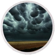 Under A Mammatus Sky Round Beach Towel