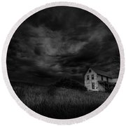 Under Threatening Skies Round Beach Towel