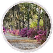 Unpaved Road With Azaleas And Oaks Round Beach Towel
