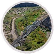 Round Beach Towel featuring the photograph Up Tracks Cross The Mojave River by Jim Thompson