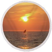 Round Beach Towel featuring the photograph Us Flag Floating At Sunrise by Robert Banach