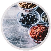 Variety Of Organic Vegan Snacks In Transparent Glass Bowls. Round Beach Towel