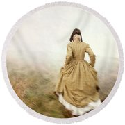 Victorian Woman Running On The Misty Moors Round Beach Towel
