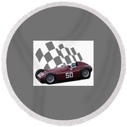 Round Beach Towel featuring the photograph Vintage Racing Car And Flag 1 by John Colley