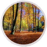 Walking In The Golden Woods Round Beach Towel