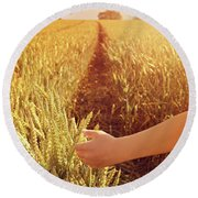 Round Beach Towel featuring the photograph Walking Through Wheat Field by Lyn Randle