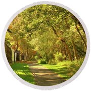 Round Beach Towel featuring the photograph Walking Under Poplars by Jim Sauchyn