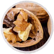 Walnuts On Wooden Table Round Beach Towel