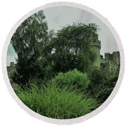 Warwick Castle Bathed In Green Light Round Beach Towel