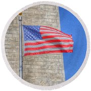 Washington Monument With The American Flag Round Beach Towel