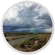 Round Beach Towel featuring the photograph Watching The Storms Roll By by Margaret Pitcher
