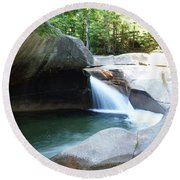Round Beach Towel featuring the photograph Water-carved Rock by Kerri Mortenson