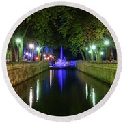 Round Beach Towel featuring the photograph Water Fountain At Night by Scott Carruthers