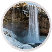 Round Beach Towel featuring the photograph Waterfall Seljalandsfoss Iceland In Winter by Matthias Hauser
