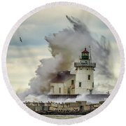 Waves Over The Lighthouse In Cleveland. Round Beach Towel