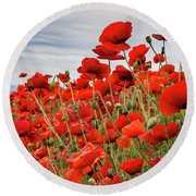 Waving Red Poppies Round Beach Towel by Jean Noren