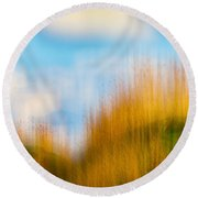 Weeds Under A Soft Blue Sky Round Beach Towel