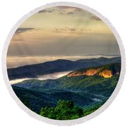 Round Beach Towel featuring the photograph Looking Glass Rock Sunrise Between The Clouds Blue Ridge Parkway by Reid Callaway