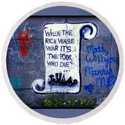 Round Beach Towel featuring the photograph When The Rich Wage War It's The Poor Who Suffer by Peter Gumaer Ogden
