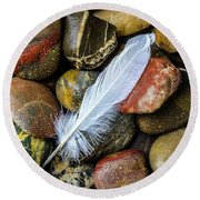 White Feather On River Stones Round Beach Towel