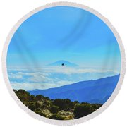 White-necked Raven Soaring Above Mount Kilimanjaro With Mount Meru Round Beach Towel by Jeff at JSJ Photography