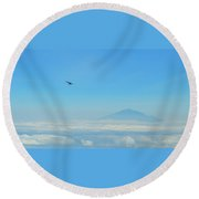 Round Beach Towel featuring the photograph White-necked Raven With Twig Soaring Over Mount Meru by Jeff at JSJ Photography