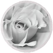 Round Beach Towel featuring the photograph White Rose Ruffles Monochrome by Jennie Marie Schell