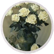 White Roses In A Rustic Green Pottery Vase On A Cupboard Shelf Round Beach Towel