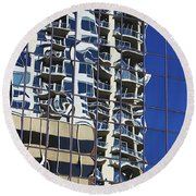 Round Beach Towel featuring the photograph Wiggly Balconies by Phyllis Denton