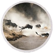 Wildebeest Leap Of Faith Into The Mara River Round Beach Towel