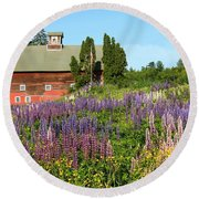 Round Beach Towel featuring the photograph Wildflowers And Red Barn by Roupen  Baker