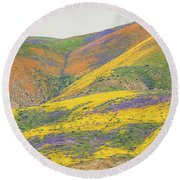Wildflowers At The Summit Round Beach Towel by Marc Crumpler